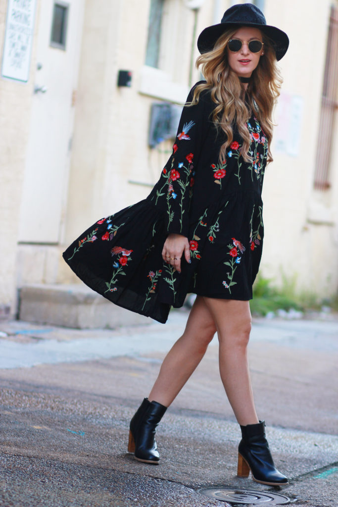 Shannon Jenkins of Upbeat Soles styles a boho fall outfit with Chicwish black embroidered dress, Sole Society black booties, and round Ray Ban sunglasses