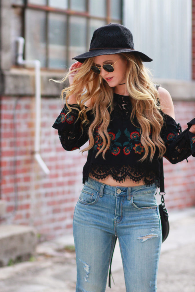 Shannon Jenkins of Upbeat Soles styles a fall boho outfit with a Forever 21 bell sleeve embroidered top. American Eagle flared jeans, Rebecca Minkoff bag
