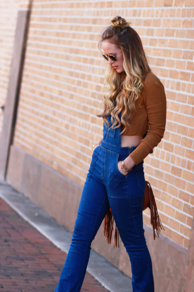Shannon Jenkins of Upbeat Soles styles a fall overall outfit with flared denim overalls, Forever 21 cropped turtleneck and fringe Sancia bag