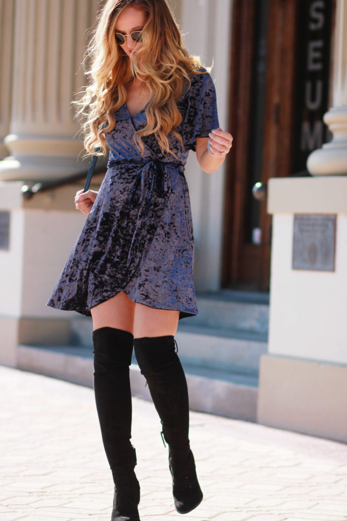Shannon Jenkins of Upbeat Soles styles sexy holiday outfit with velvet American Eagle dress, Dolce Vita over the knee boots, and round Ray Ban sunglasses