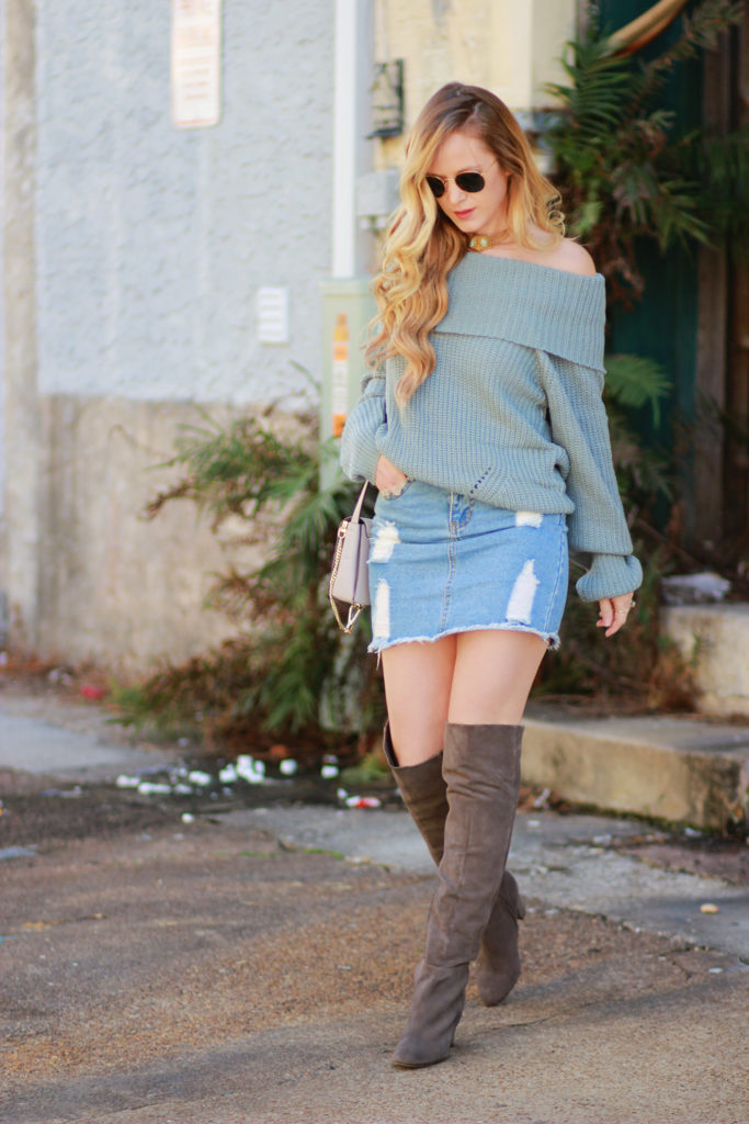 Shannon Jenkins of Upbeat Soles styles edgy fall outfit with oversized sweater, denim mini skirt, grey suede over the knee boots, and Chloe Fay dupe
