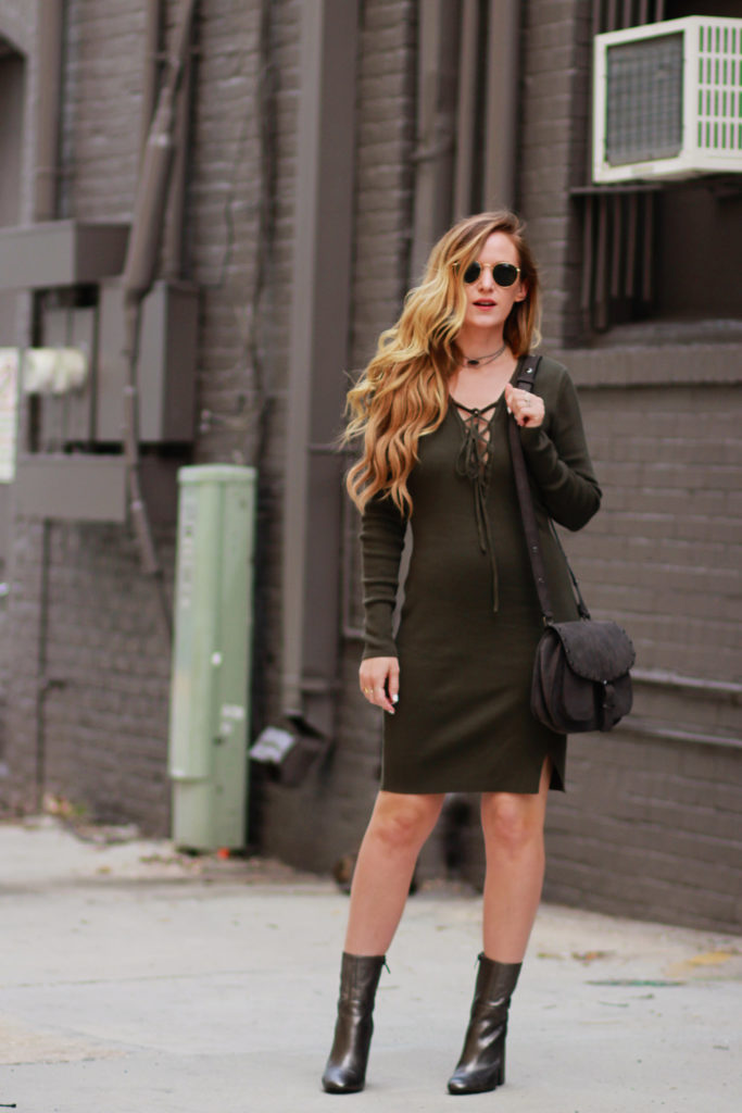 Shannon Jenkins of Upbeat Soles styles a fall date night outfit WAYF olive lace up dress, Kendall and Kylie silver booties, Rebecca Minkoff biker saddle bag