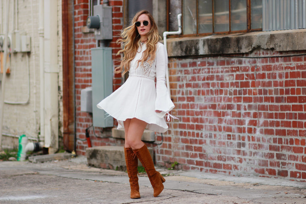 Shannon Jenkins of Upbeat Soles styles a bohemian fall outfit with lace bell sleeve dress, Matisse lace up boots, and round Ray Ban sunglasses