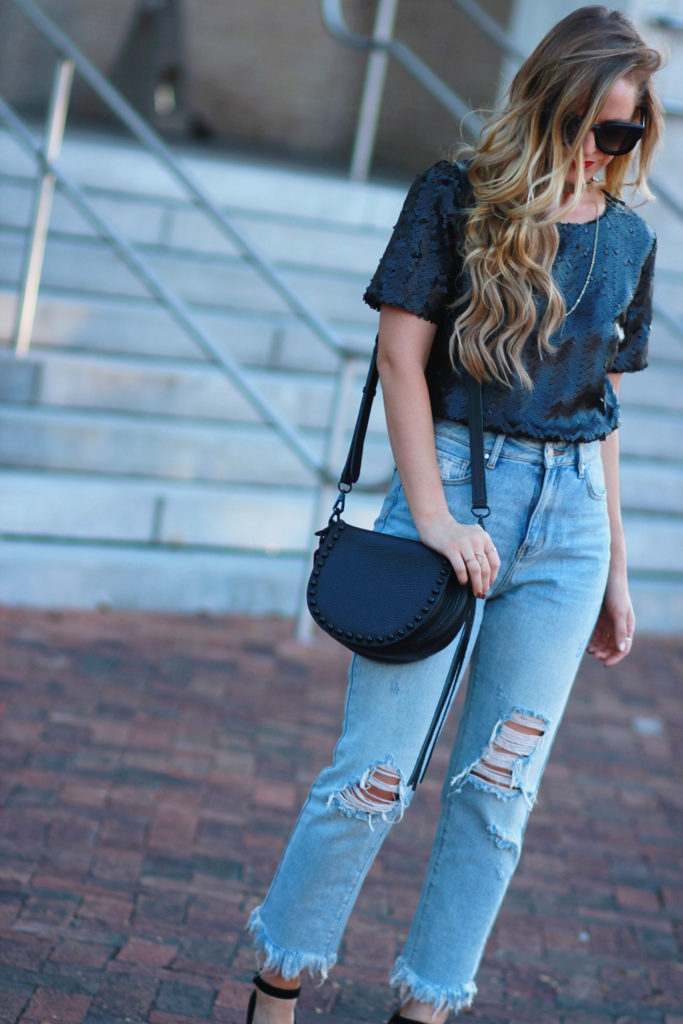 Shannon Jenkins of Upbeat Soles styles a holiday party outfit with black sequin top, distressed boyfriend jeans, and DSW Marc Fisher suede heels
