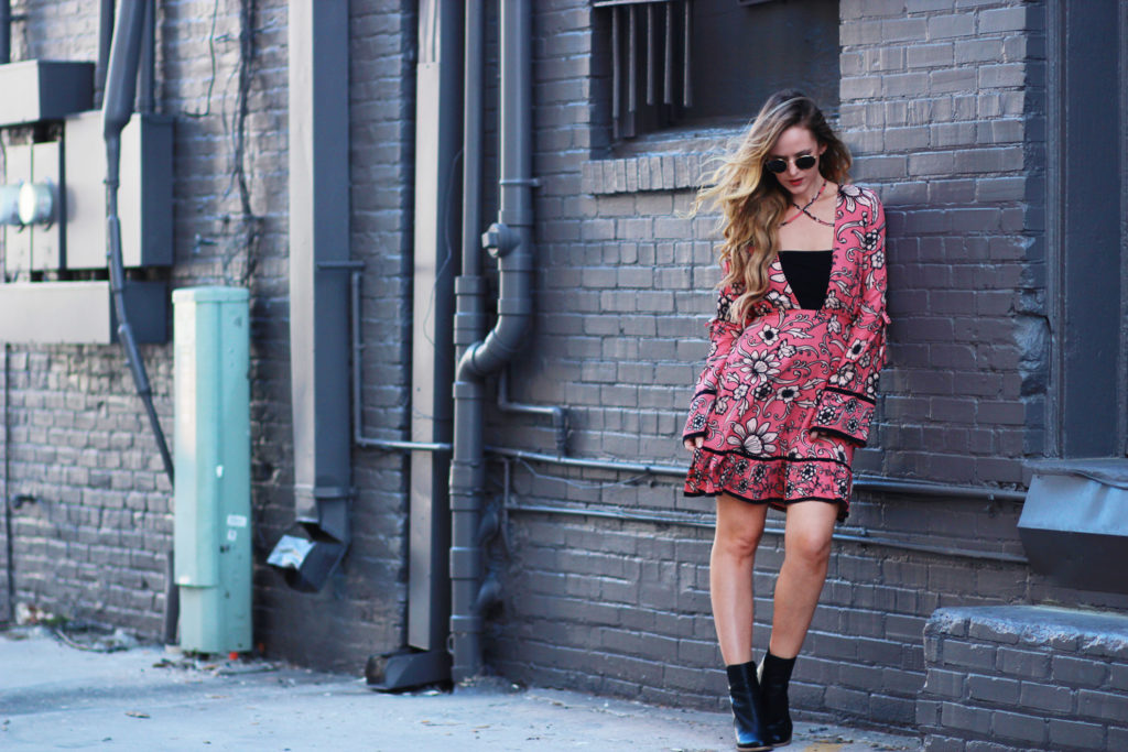 Shannon Jenkins of Upbeat Soles styles casual boho fall outfit with Planet Blue For Love and Lemons floral dress, black Sole Society booties, and Ray Bans