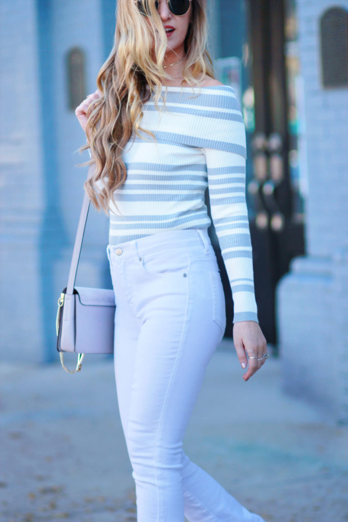 Shannon Jenkins of Upbeat Soles styles casual winter outfit with Chicwish striped off the shoulder sweater, white flared jeans, and Kendra Scott choker