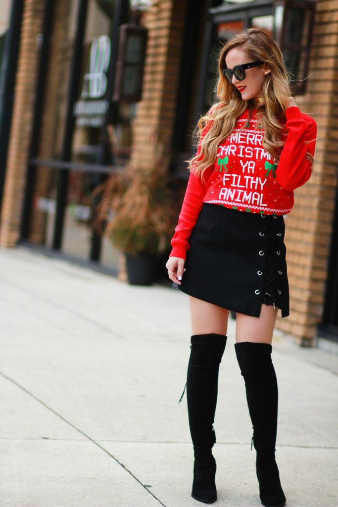 Shannon Jenkins of Upbeat Soles styles an ugly Christmas sweater party outfit with Joe Boxer sweater, Chicwish lace up skirt, and Dolce Vita otk boots