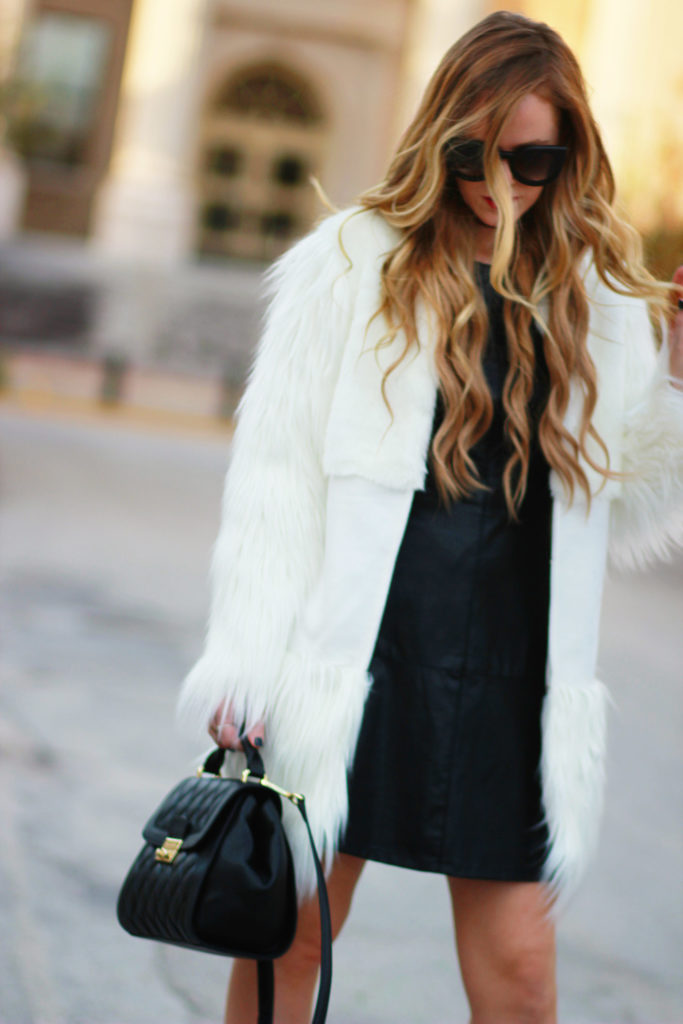 Shannon Jenkins of Upbeat Soles styles a winter date night outfit with Chicwish fur coat, faux leather dress, sparkly heels, and Valley Eyewear sunglasses