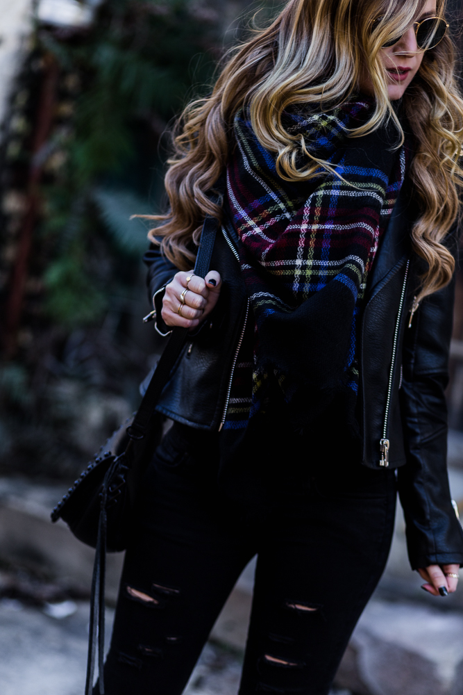 Shannon Jenkins of Upbeat Soles styles an all black winter outfit with Blank Denim leather jacket, DSTLD jeans, plaid blanket scarf, and Sole Society boots