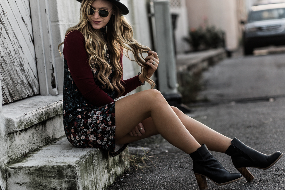 Shannon Jenkins of Upbeat Soles styles boho winter outfit styled with BCBGeneration floral shift dress, Sole Society booties, and round Ray Ban sunglasses