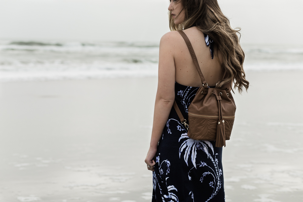 Shannon Jenkins of Upbeat Soles styles casual spring outfit with Tommy Bahama maxi dress, gladiator sandals, and leather backpack