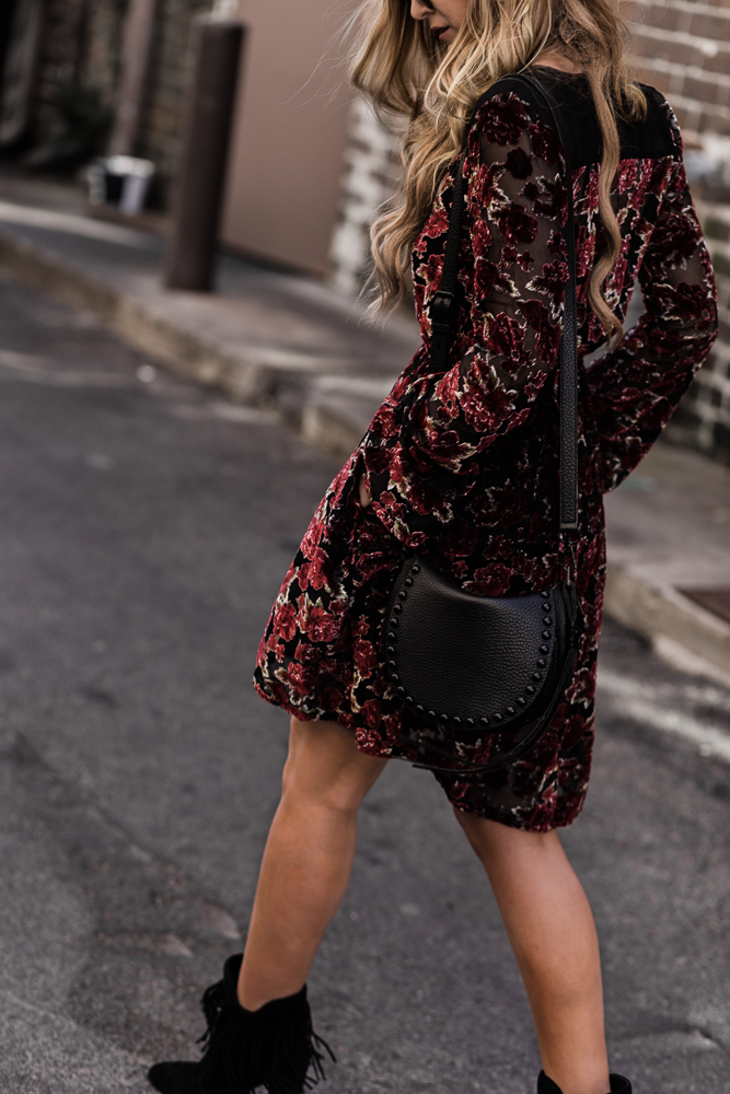 Shannon Jenkins of Upbeat Soles styles a romantic Valentine's Day outfit with Band of Gypsies floral velvet dress, Antonio Melani fringe booties