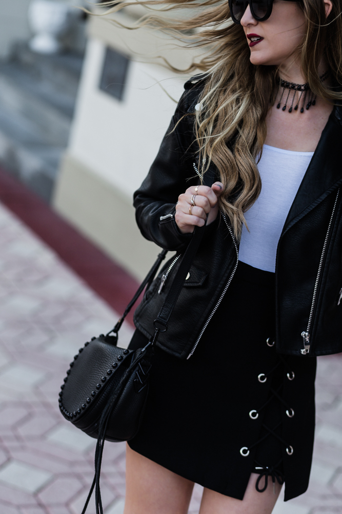 Shannon Jenkins of Upbeat Soles styles edgy black and white outfit, Blank NYC leather jacket, Tillys off the shoulder top, lace up skirt, and Icing choker