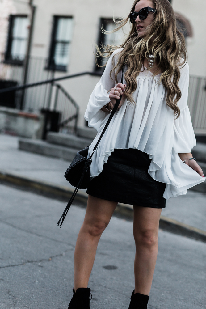 Shannon Jenkins of Upbeat Soles partners with Capri Blue candals for edgy black and white outfit with Forever 21 mini skirt and Antonio Melani fringe boots