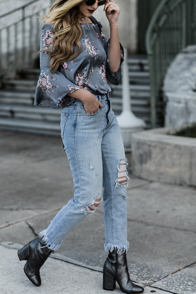 Shannon Jenkins of Upbeat Soles styles a floral spring outfit with Vici floral outfit, distressed mom jeans, Kendall and Kylie metallic booties