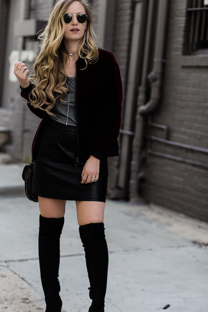 Shannon Jenkins of Upbeat Soles styles bomber jacket outfit with BCBGeneration velvet bomber, forever 21 leather skirt, and Rebecca Minkoff biker bag