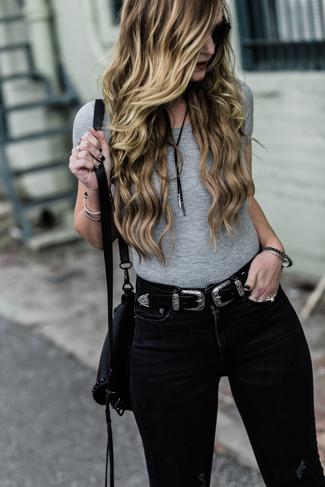 Shannon Jenkins of Upbeat Soles shows how to style flared jeans for spring with Abercrombie lace up bodysuit and Rebecca Minkoff saddle bag