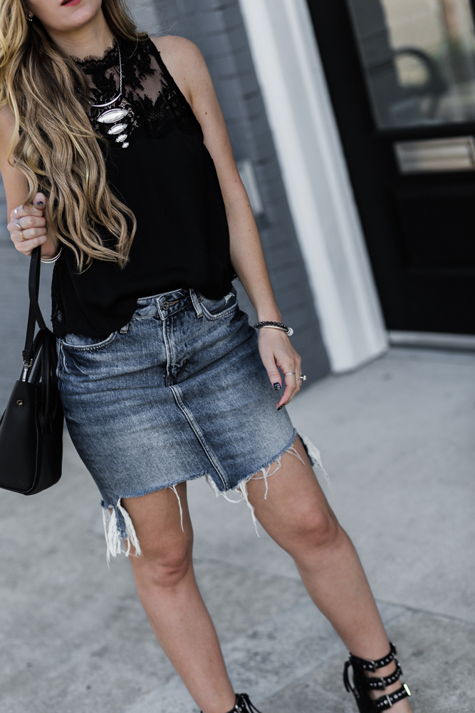 Shannon Jenkins of Upbeat Soles styles a casual spring outfit with lace Free People crop top, H&M denim skirt, Dolce Vita Edin sandal, and Hieleven bag