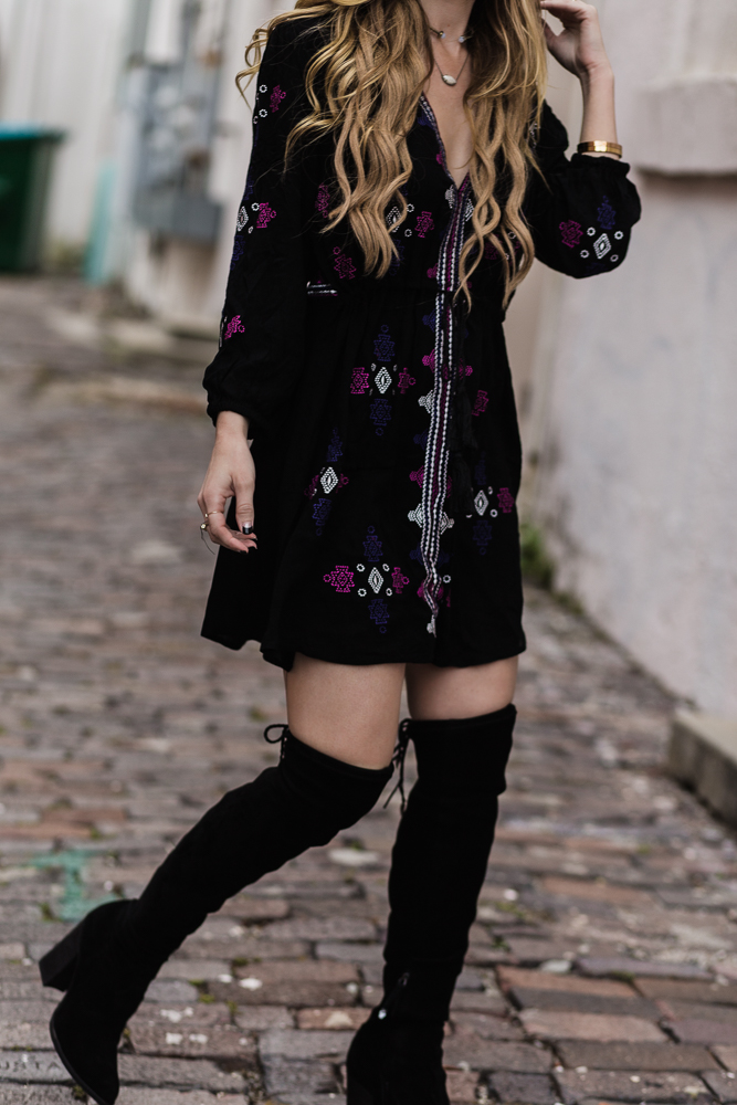 Shannon Jenkins of Upbeat Soles shows how to style a boho embroidered dress with black over the knee boots, and round Ray Ban sunglasses