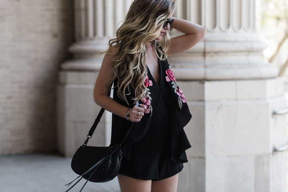 Shannon Jenkins of Upbeat Soles styles sexy date night outfit with Tiger Mist embroidered romper, black booties, and Valley Eyewear sunglasses