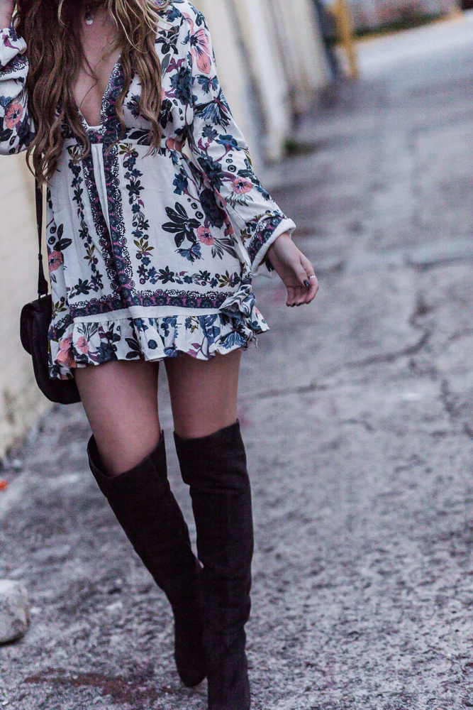 Shannon Jenkins of Upbeat Soles shows how to style over the knee boots for spring with Free People floral dress, Rebecca Minkoff biker bag, and Ray Bans