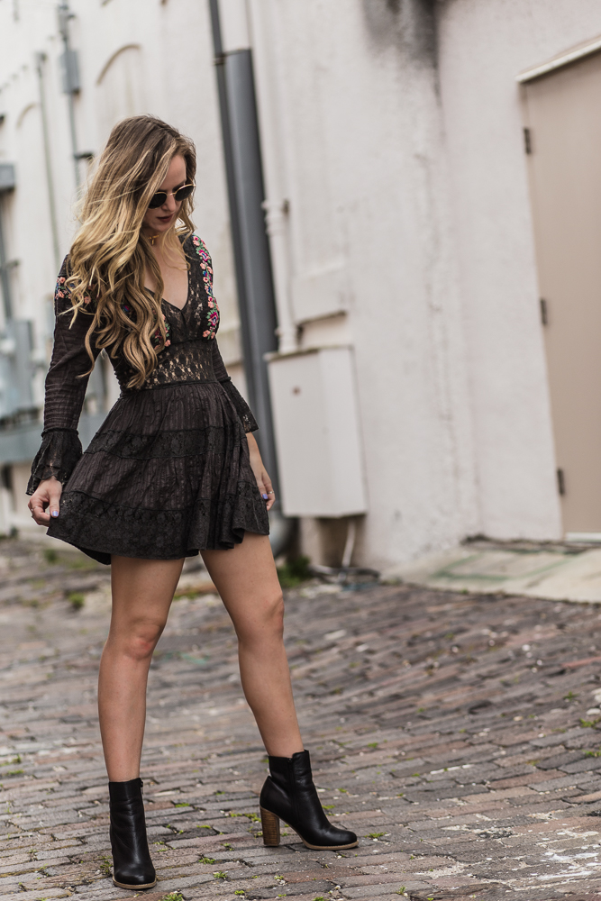 Shannon Jenkins of Upbeat Soles styles a spring boho outfit with embroidered Free People dress, Sole Society booties, and round Ray Ban sunglasses