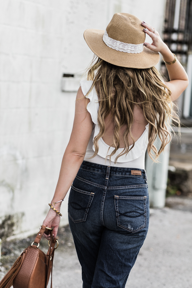Shannon Jenkins of Upbeat Soles styles casual spring outfit with ruffle bodysuit, highwaisted Abercrombie boyfriend jeans, and Dolce Vita Effie sandals
