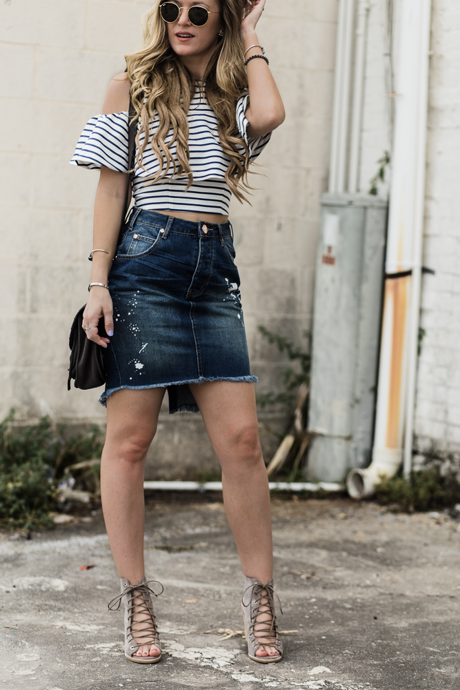 Shannon Jenkins of Upbeat Soles styles casual spring outfit styled with striped ruffle crop top, One Teaspoon denim skirt, and Jeffrey Campbell lace up shoe