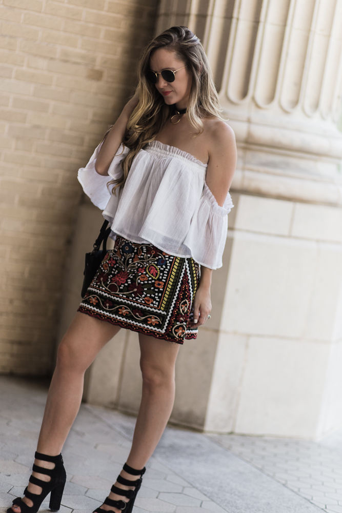 Shannon Jenkins of Upbeat Soles styles a summer date night outfit with embroidered mini skirt, white off the shoulder top, and Kendall & Kylie heels