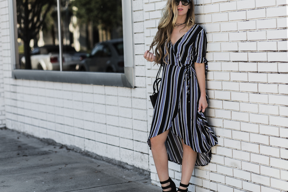 Shannon Jenkins of Upbeat Soles styles a casual date night outfit with striped wrap dress, Kendall and Kylie Evie heels, and Hieleven bag