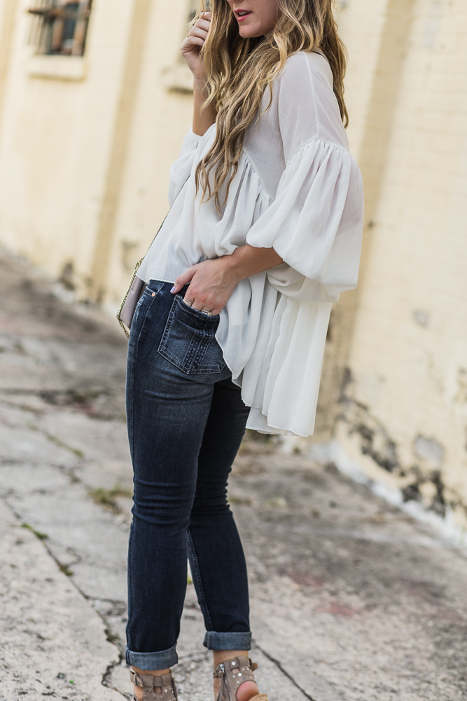 Shannon Jenkins of Upbeat Soles styles boho fall transition outfit with Riders by Lee skinny jeans, chicwish flowy top, and Dolce Vita block heel sandals