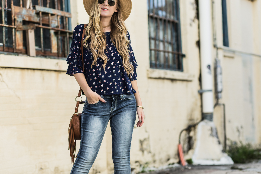 Shannon Jenkins of Upbeat Soles styles an easy weekend outfit with True Craft by Belk floral top, skinny jeans, Jefferey Campbell wedges, and Sancia bag