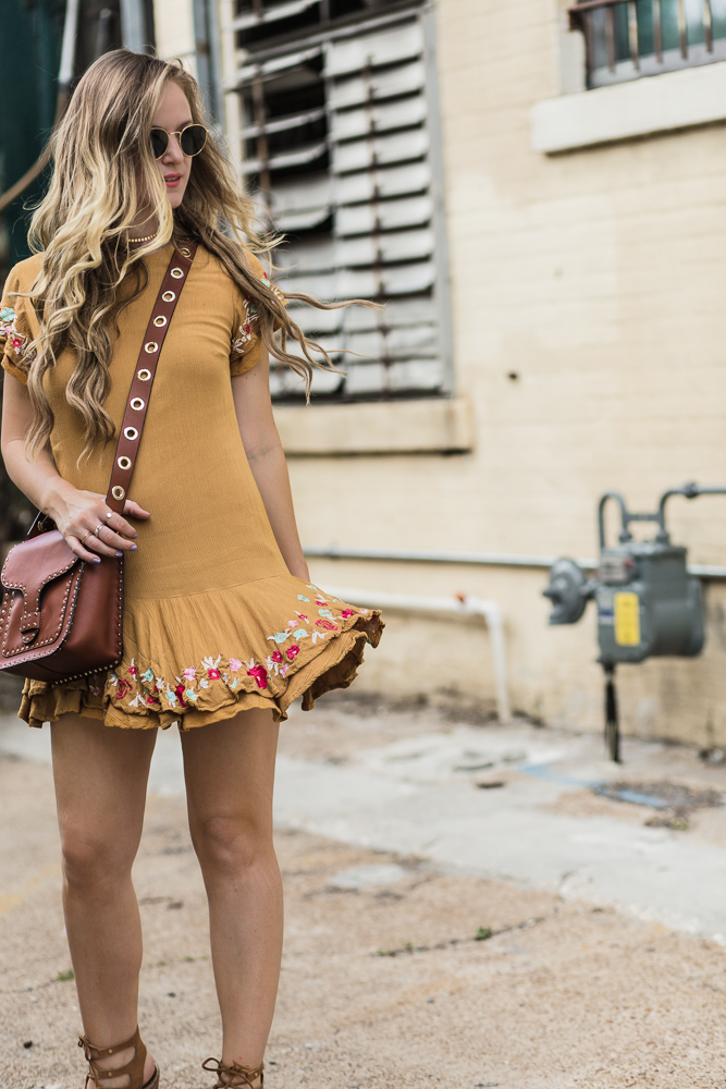 Shannon Jenkins of Upbeat Soles styles an embroidered boho RahiCali mustard dress with Dolce Vita lace up sandals, and Rebecca Minkoff top handle feed bag
