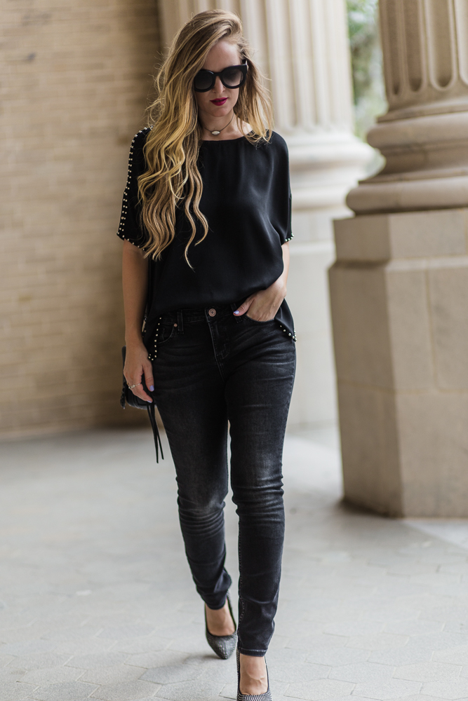 Shannon Jenkins of Upbeat Soles styles a cute date night outfit with silver studded top, black Riders by Lees skinny jeans, and black studded pumps