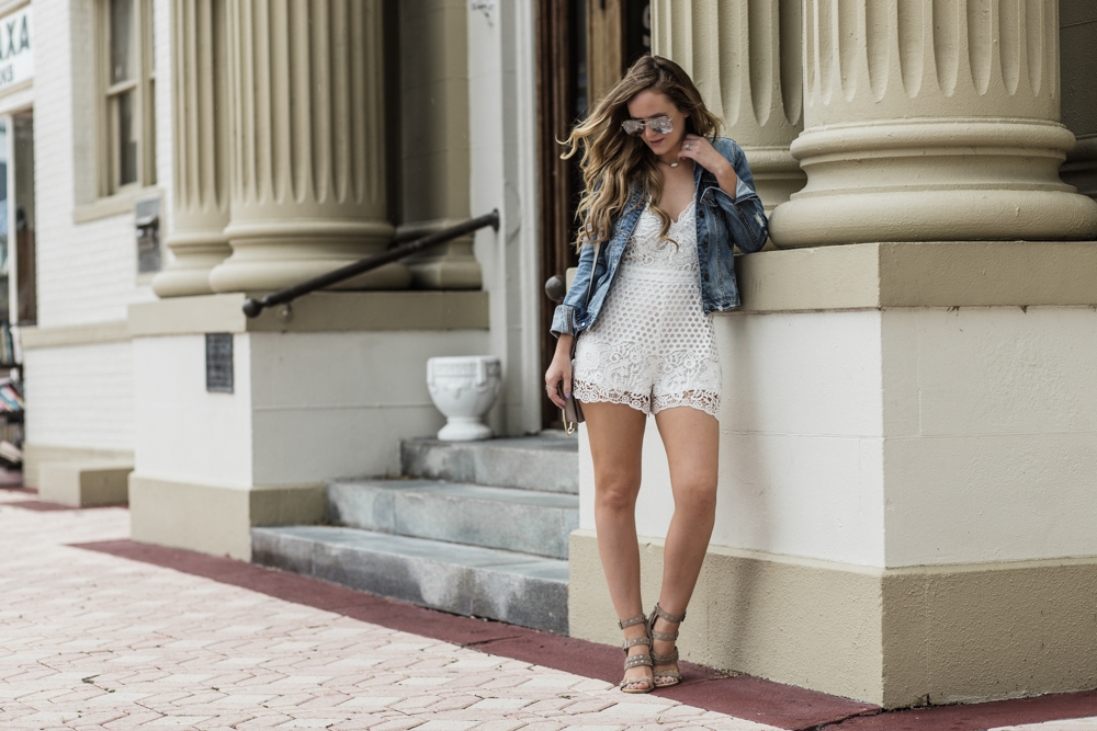 Shannon Jenkins of Upbeat Soles styles a cute brunch look with lace romper from Blush Elegance, DSTLD denim jacket, and Dolce Vita Effie sandals