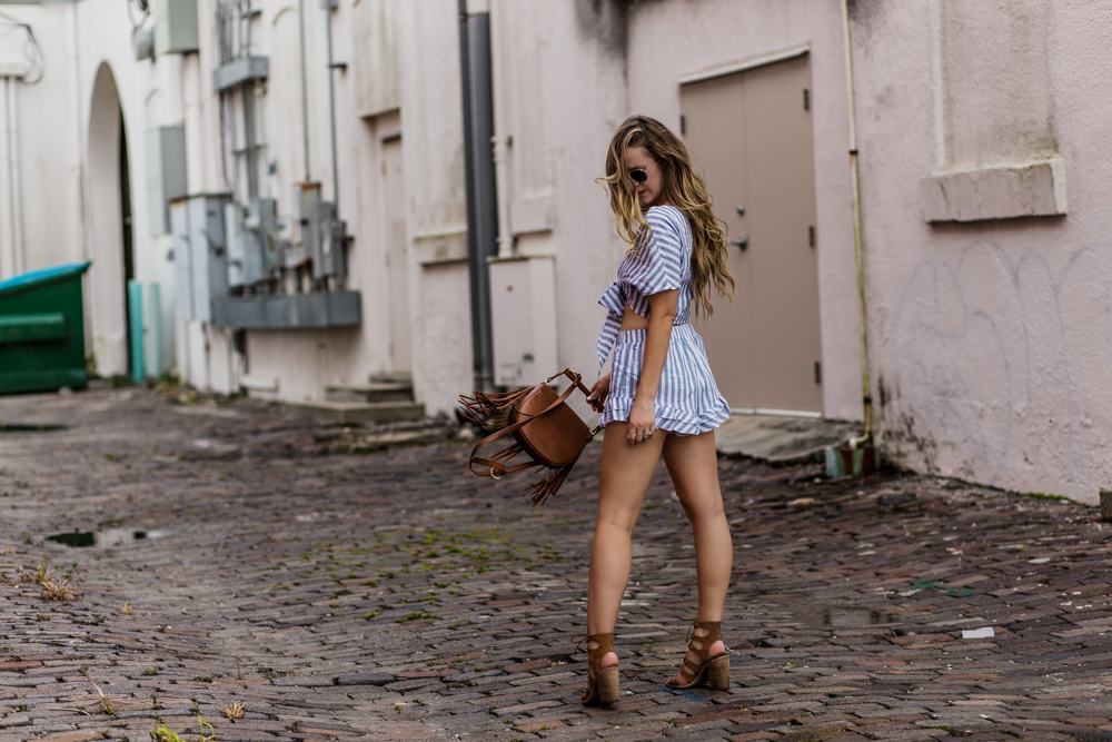 Shannon Jenkins of Upbeat Soles styles a boho two piece set from Shein with Dolce Vita lace up block heels, Sancia crossbody bag, and round Ray Bans