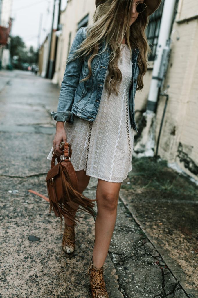Shannon Jenkins of Upbeat Soles styles a cute weekend fall transition outfit with lace Free People dress, distressed jean jacket and leopard Matisse booties