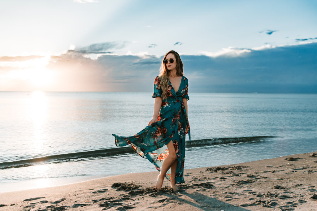 Shannon Jenkins of Upbeat Soles styles a cute vacation outfit with turquoise floral maxi dress and round Ray Ban sunglasses