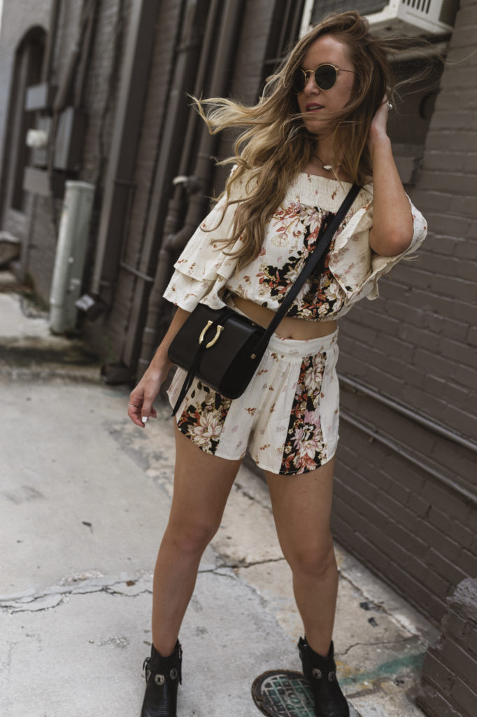 Shannon Jenkins of Upbeat Soles styles a boho fall transition outfit with Band of Gypsies 2 piece set, Dolce Vita booties, and Sancia cross body bag