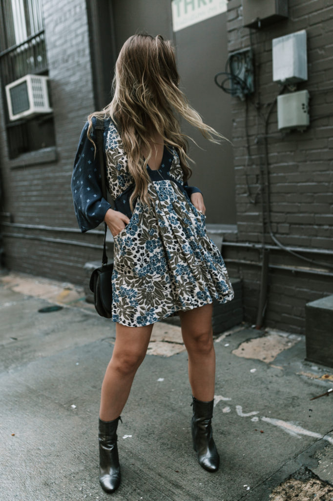 Shannon Jenkins of Upbeat Soles styles edgy fall outfit with Free People floral dress, Kendall and Kylie booties, and Rebecca Minkoff Biker bag