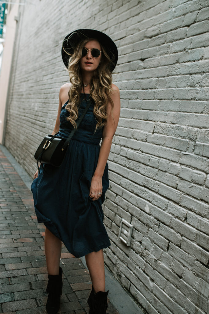 Shannon Jenkins of Upbeat Soles styles a fall transition outfit with Lucky Brand chambray midi dress, fringe suede booties, and Sancia cross body bag
