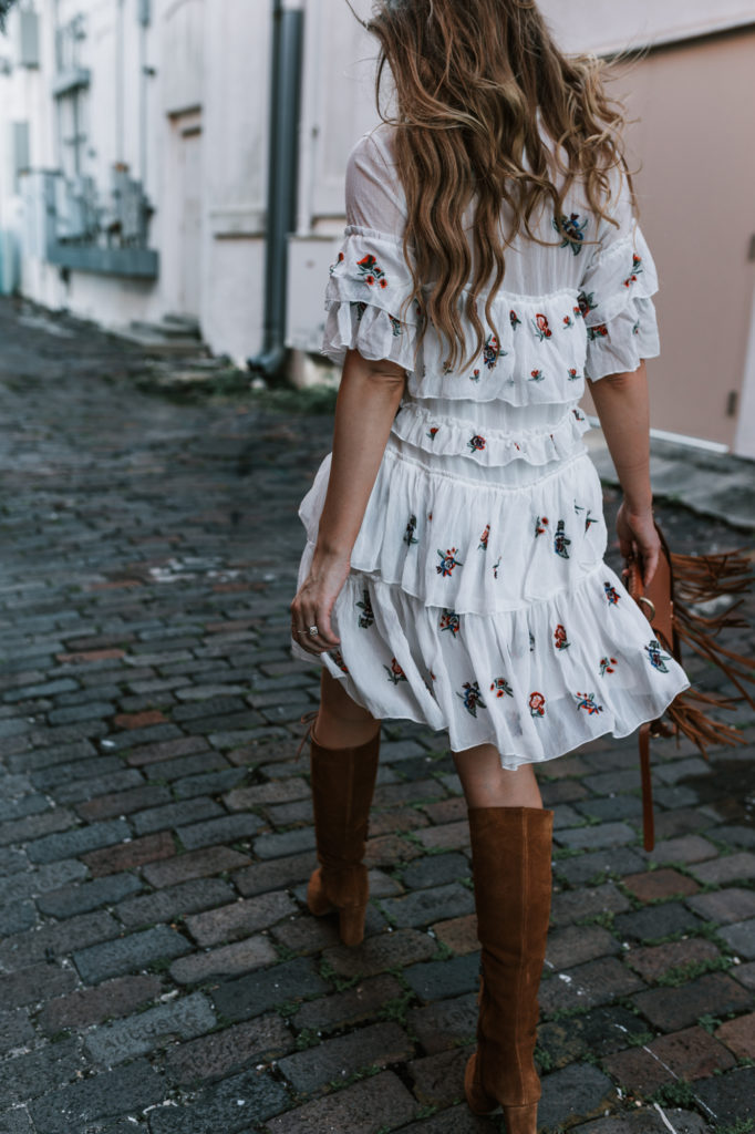 Shannon Jenkins from Upbeat Soles styles a fall transition outfit in an embroidered Chicwish dress with Matisse lace up boots and a Sancia fringe bag