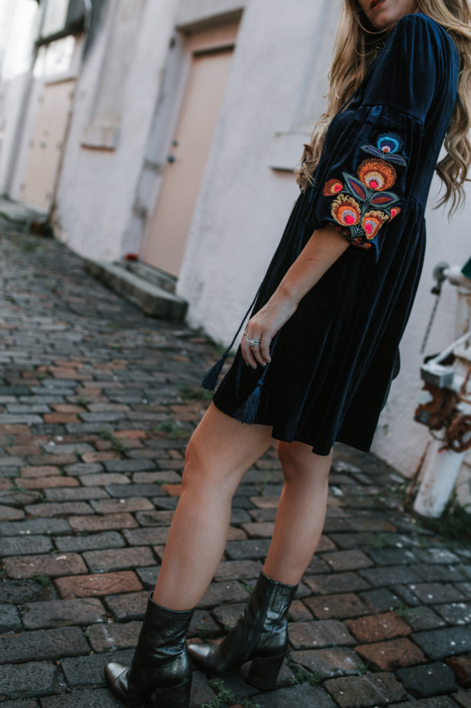 Shannon Jenkins of Upbeat Soles styles a fall date night outfit with Chicwish boho velvet embroidered dress, metallic booties, and Rebecca Minkoff biker bag