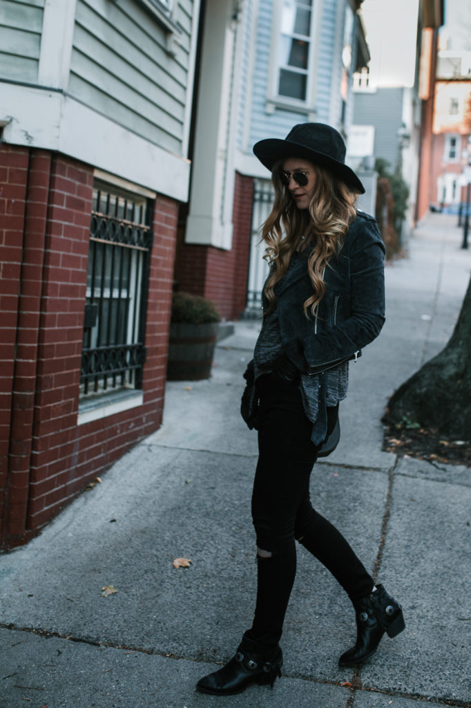 Shannon Jenkins from the Fashion Blog Upbeat Soles wears a warm fall outfit with a suede moto jacket, high rise jeans, and western booties