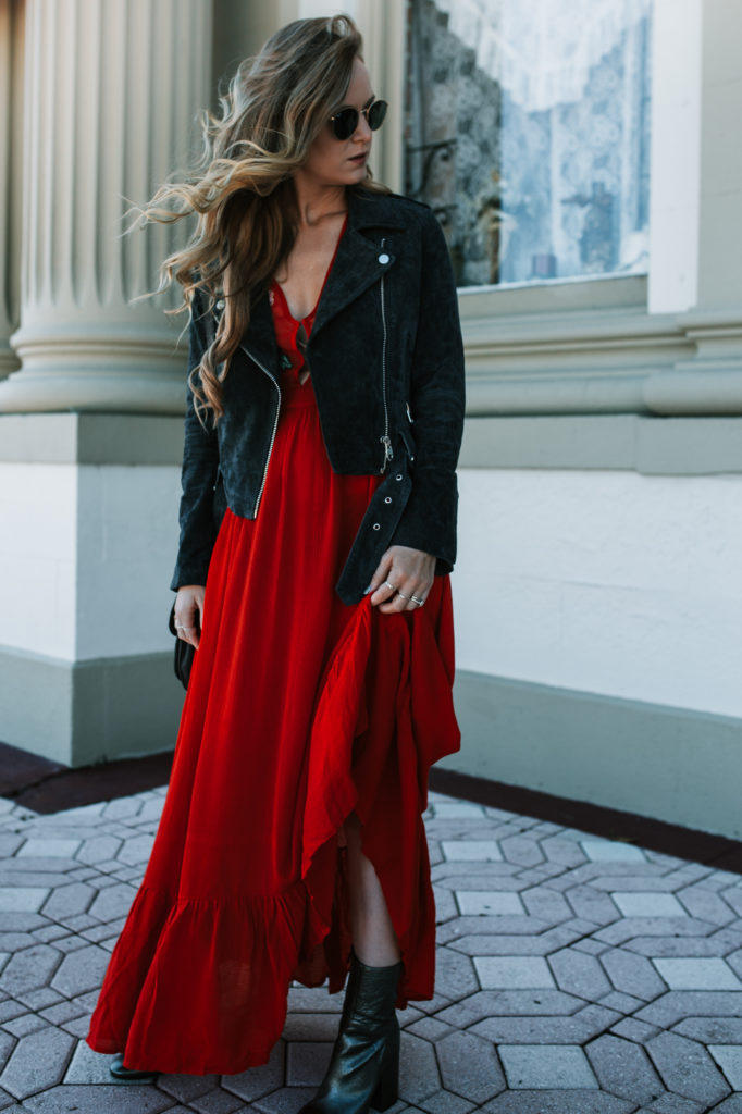 Shannon Jenkins from fashion blog Upbeat Soles styles an embroidered dress with a suede moto jacket and silver booties
