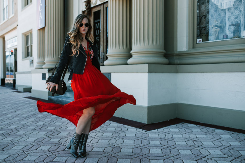 Shannon Jenkins from fashion blog Upbeat Soles styles a maxi for fall with an embroidered dress with a suede moto jacket and silver Kendall & Kylie booties