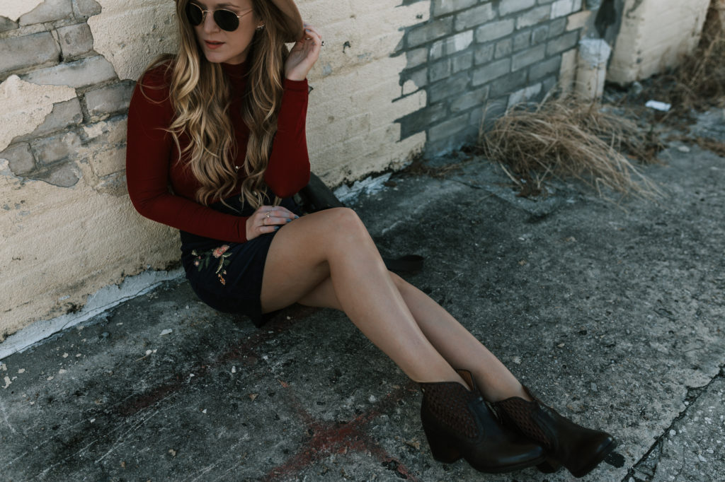Shannon Jenkins from Orlando Fashion Blog Upbeat Soles styles brown Bussola booties with an embroidered corduroy skirt and maroon turtleneck