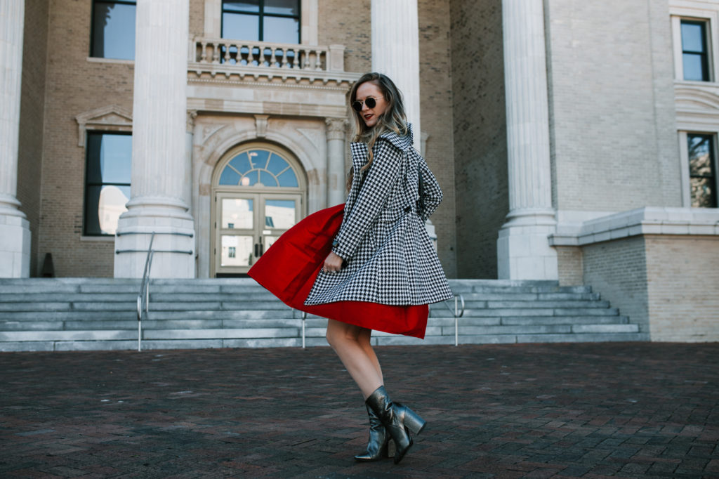 Shannon Jenkins of Upbeat Soles styles a holiday party outfit with Gianni Bini red dress, houndstooth coat, and metallic booties