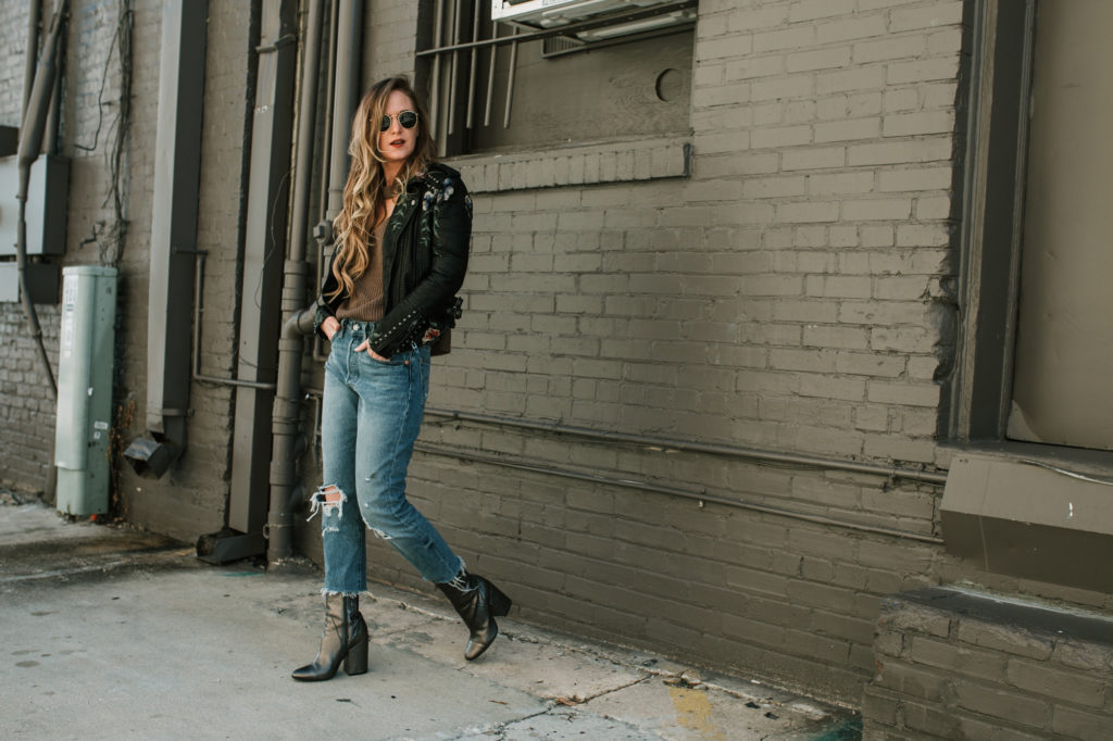 Shannon Jenkins from the fashion blog Upbeat Soles styles an embroidered leather jacket with distressed Levi Jeans with metallic booties