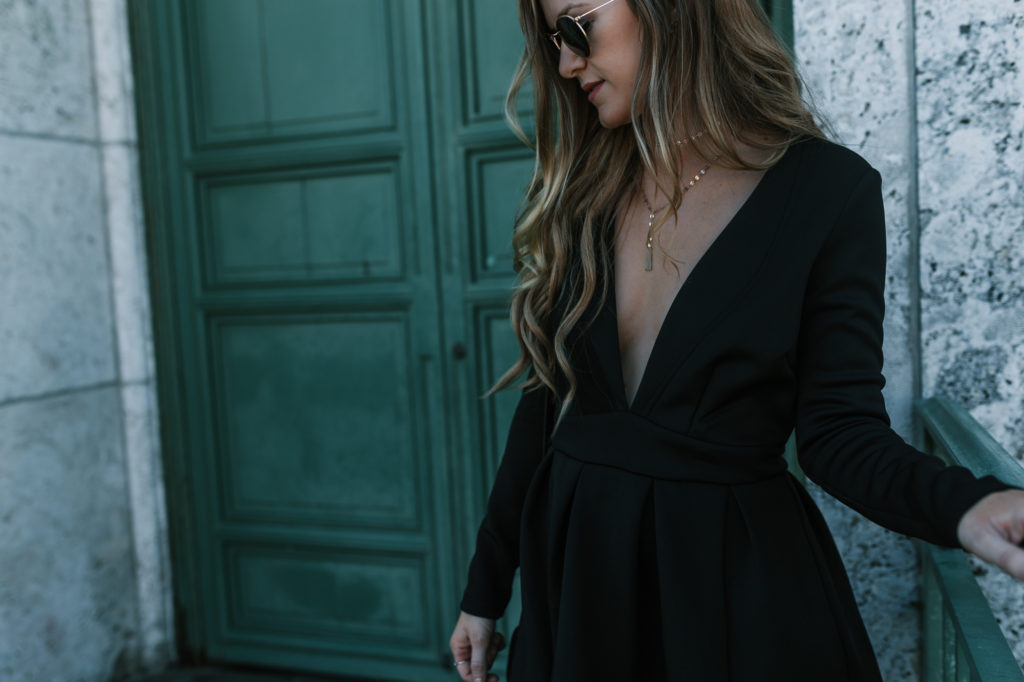 Fashion Blogger Shannon Jenkins of Upbeat Soles styles a cute New Years Eve outfit with black dress from Akira with Kendall & Kylie metallic booties